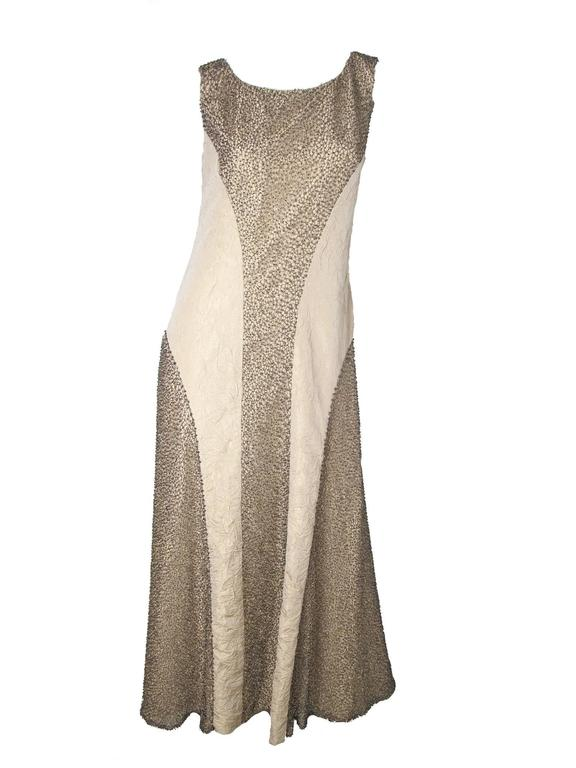 Chanel evening gown with metallic thread and beading c. 2000.  Condition: Very good, make up on label. Acetate and silk fabric.  Size 40 /US 6- 8  We accept returns for refund, please see our terms.  We offer free ground shipping within the US.
