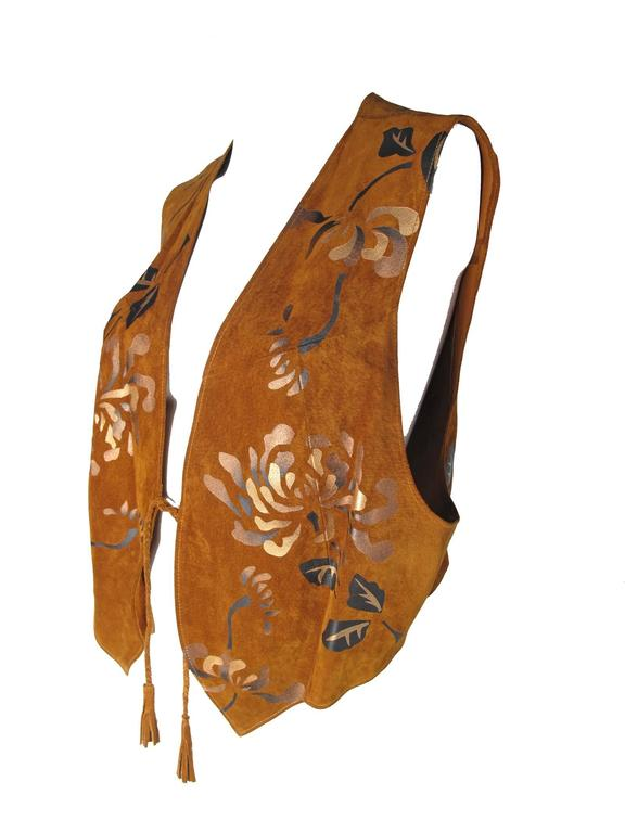 1980s brown suede vest with bronze painted leaf detail. Condition: Very good.