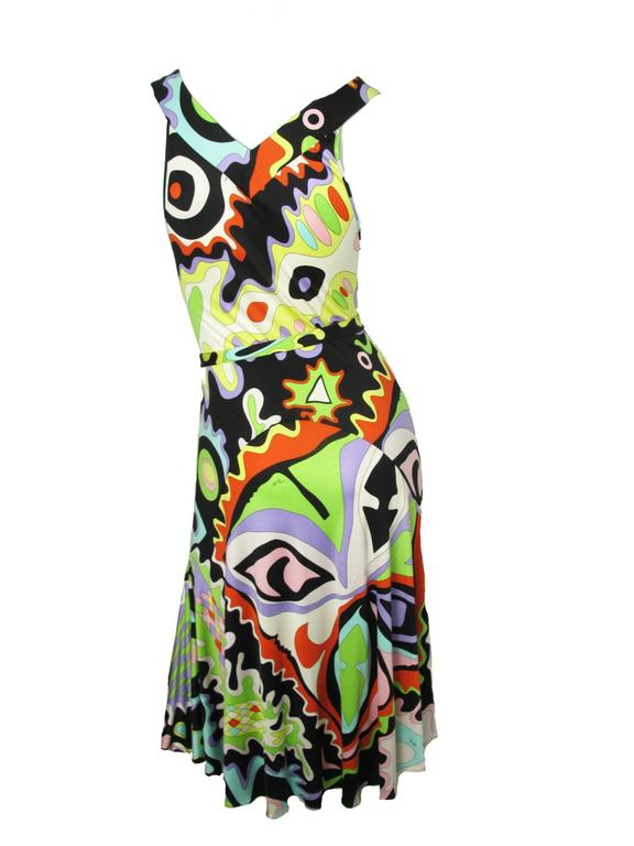 Pucci silk printed dress with belt.  Condition: Good, some pulls and small spot. Size 8  We accept returns for refund, please see our terms.  We offer free ground shipping within the US.  Please let us know if you have any questions.