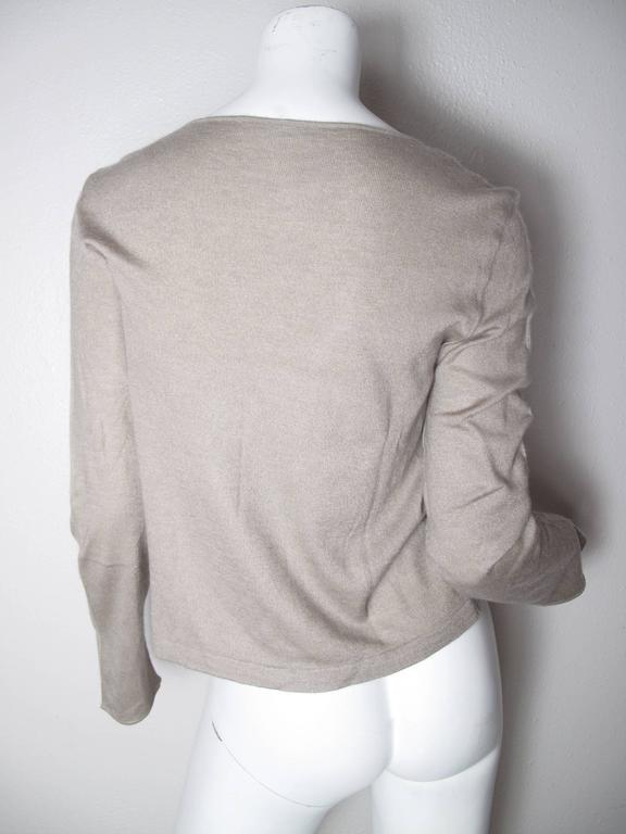 Chanel beige cashmere pull over sweater.  Chanel metal tag on front.  Condition:Very good - missing Chanel inside label.   Size 42