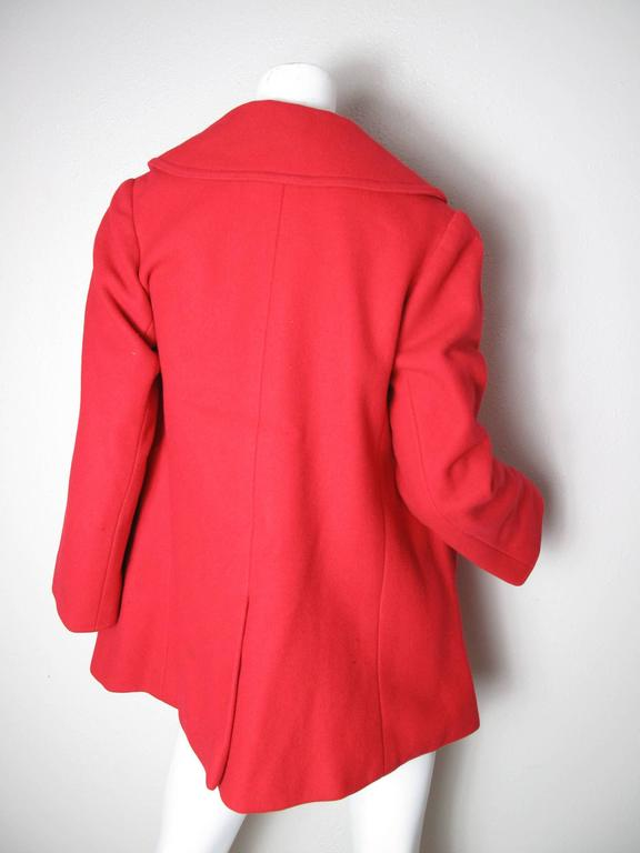 1970s Yves Saint Laurent red wool pea coat.  Condition: As is, a few spots, and lining has been sewn. Size 6 