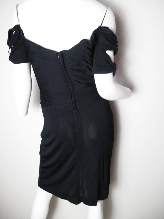 Vicky Tiel black jersey cocktail dress with gathered top and sheer skirt, ties at sleeves. Boning in bodice . 37