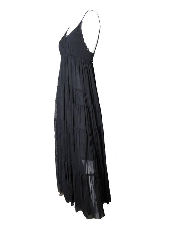 Jean Paul Gaultier long black sheer mesh gown with spaghetti straps and lace trim at collar.  Nylon fabric. Fabric is stretchy. Condition: Excellent Size L  We accept returns for refund, please see our terms. We offer free ground shipping within