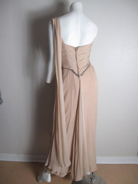 Emma Domb one shoulder chiffon gown with faux pearl, beading and rhinestone trim.  Condition: Good, some spots.   Label Size 14/ fits current size 8 - 10  We accept returns for refund, please see our terms.  We offer free ground shipping within the