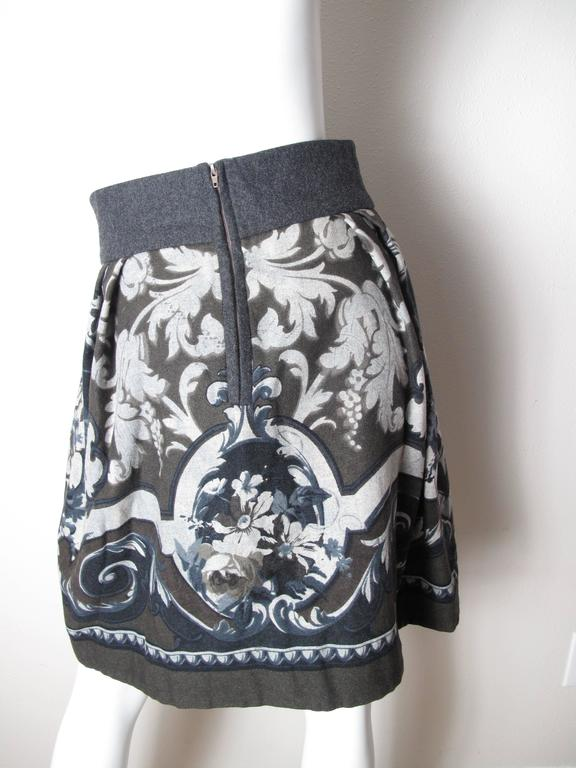 Byblos wool charcoal skirt with brown and grey print.  Opening in front. Condition: Excellent.  Size 40 / US 6  We accept returns for refund, please see our terms. We offer free ground shipping within the US.  Please let us know if you have any
