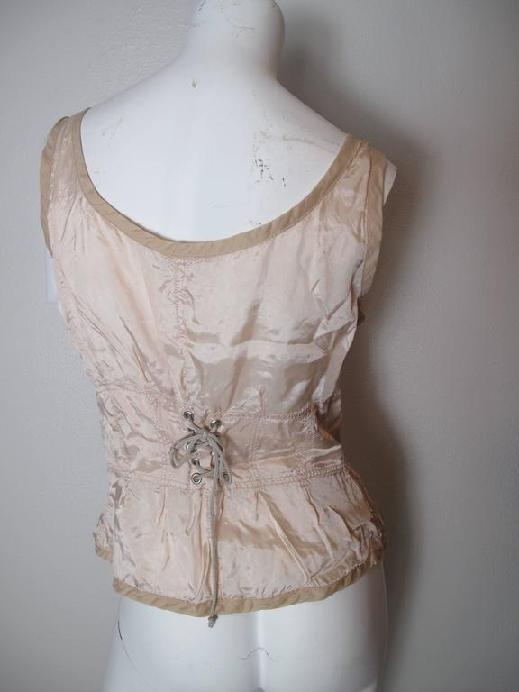 1990s Prada pale pink zip up viscose bustier with lacing at back.  Condition: Excellent, original tags still attached.  Size L  We accept returns for refund, please see our terms.  We offer free ground shipping within the US. Let us know if you have