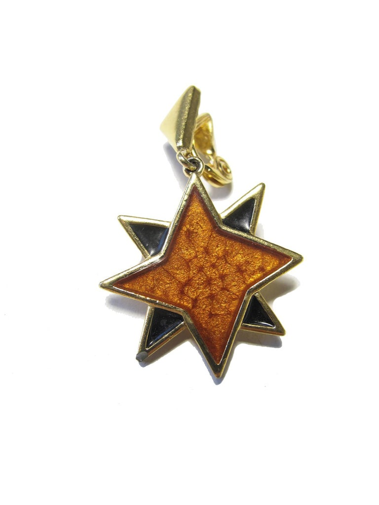 1980s Yves Saint Laurent enamel and metal star earrings. Clip on.  Condition: Very good, some wear. We accept returns for refund, please see our terms.  We offer free ground shipping within the US.