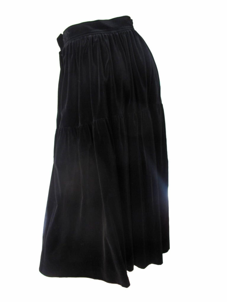 1980s Yves Saint Laurent black velvet peasant skirt.  Condition: Very good. Size 40/ current us 6 We accept returns for refund, please see our terms.  We offer free ground shipping within the US.