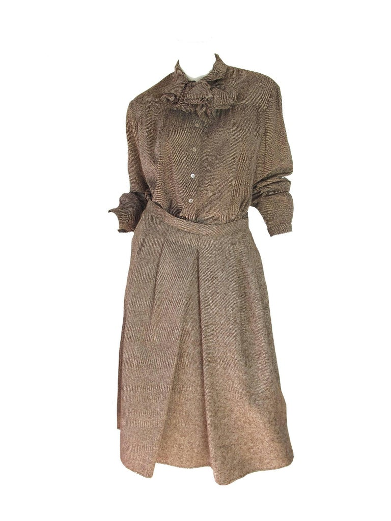 Geoffrey Beene 3 Piece Skirt Suit, 1970s.  Silk blouse, wool jacket and skirt.  silk neck collar. Condition: Excellent.  labeled Size 16, fits current size 14  We accept returns for refund, please see our terms. We offer free ground shipping within