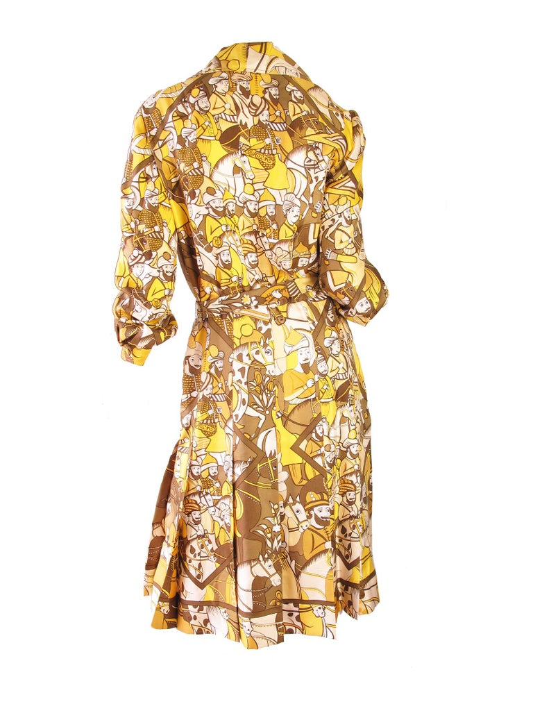 1970s Hermes silk printed dress with removable belt.  Condition: Very good, spot and pull on collar, see photos. Size 8 - 10  We accept returns for refund, please see our terms.  We offer free ground shipping within the US