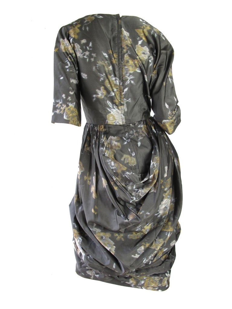 Amazing 1950s Ceil Chapman floral silk dress with draping.  Condition : Excellent. Size 6 / 8   We accept returns for refund, please see our terms.  We offer free ground shipping within the US.