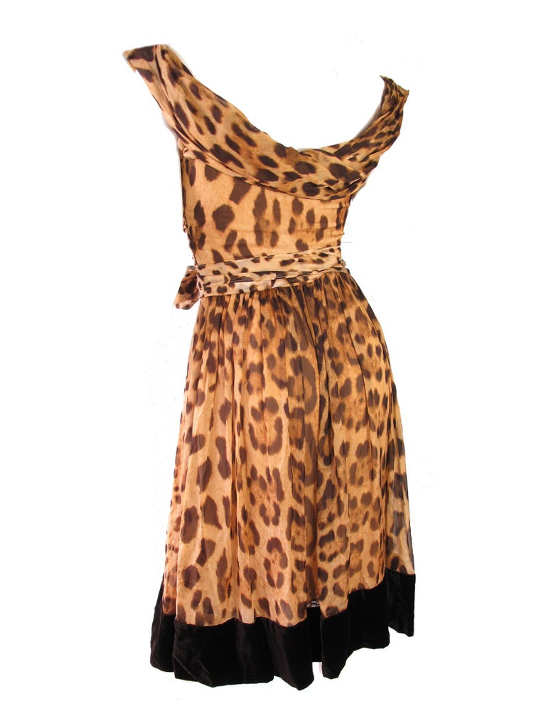 Gorgeous Dolce and Gabbana silk chiffon leopard print dress with velvet trim. Classic Dolce and Gabbana! Condition:Excellent. Size US 6 / EU 40  We accept returns for refund, please see our terms.  We offer free ground shipping within the US.