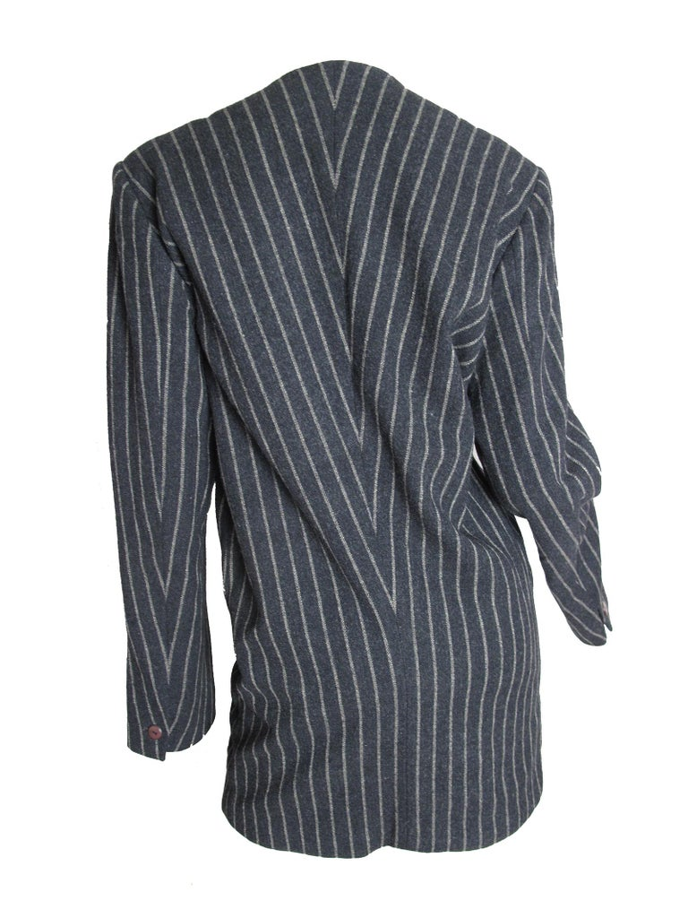 Issey Miyake wool, nylon blazer, 1980s.  Made in Japan.  Condition: Excellent.  Size 8 (mannequin is US size 6)  We accept returns for refund, please see our terms.  We offer free ground shipping within the US.  Please let us know if you have any
