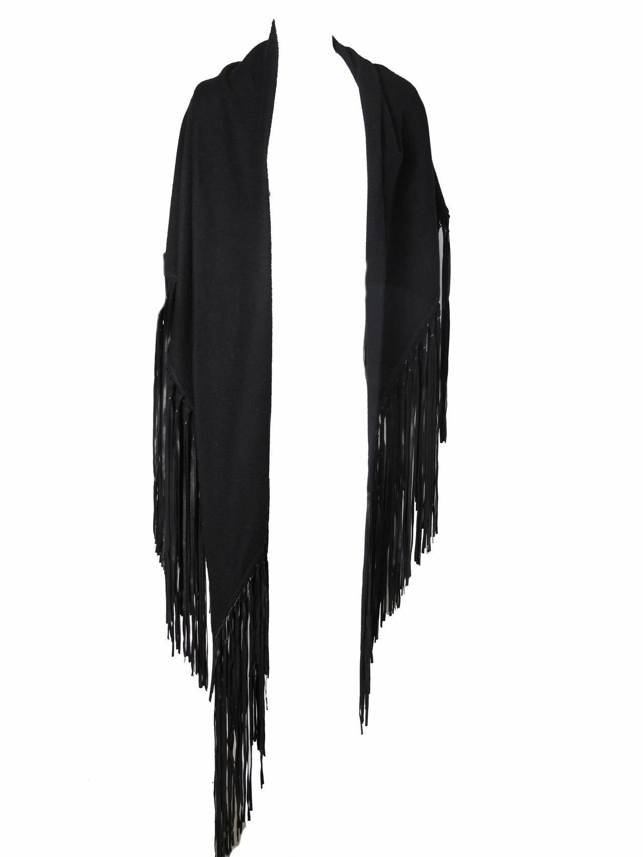 "1980s Hermes Black Wool Shawl with Leather Fringe.  Condition: Excellent. Triangle shape:  90"" L x 37 1/2"" H  ( before tassel ) 