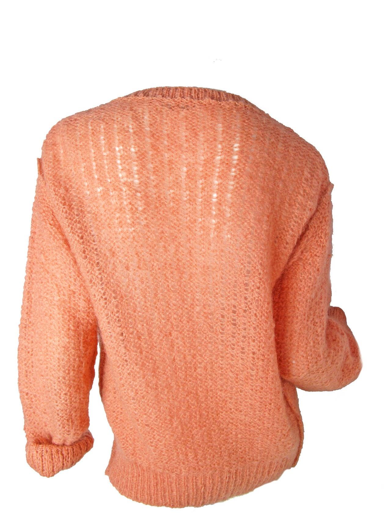 """Sonia Rykiel pink wool cardigan, tie at bottom, button at top.  Condition: Excellent.   40"""" bust, 32"""" waist, 24"""" sleeve, 26"""" length.   Size 42/ US 8  We accept returns for refund, please see our terms.  We offer free ground shipping within the"""