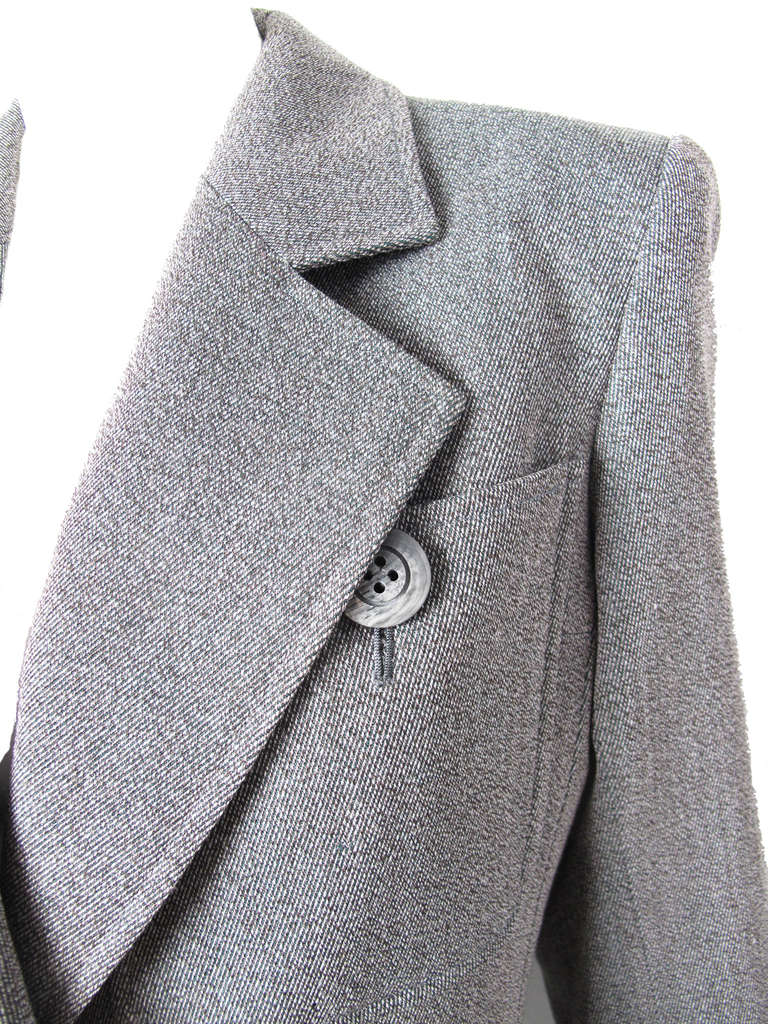 Yves Saint Laurent grey wool suit.  Two front pockets on jacket.  Two pockets on skirt. Jacket: 39