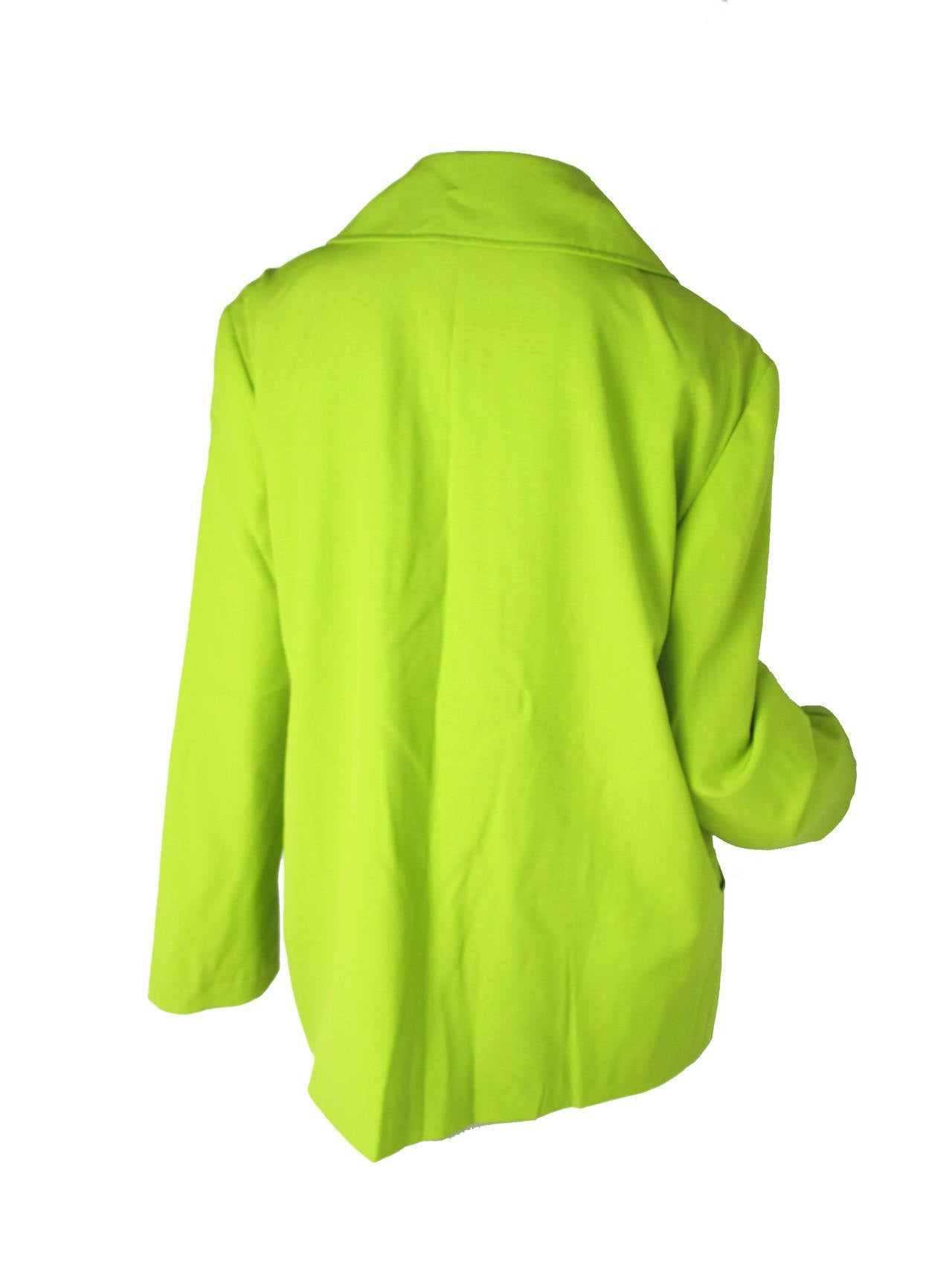 "Christian Lacroix neon green light wool jacket with Two front pockets.  Made in Italy.  44"" bust, 44"" waist, 24 1/2"" sleeve, 18"" shoulder, 27 1/2"" length. Condition: Excellent. Size 14"