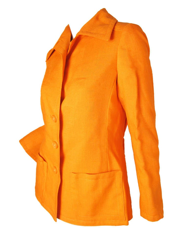 """1960s Geoffrey Beene Boutique orange linen jacket. 38"""" bust, 34"""" waist, 24"""" sleeve, 15 1/2"""" shoulder, 26"""" length.  Buttons down front, two large pockets.  Condition: Excellent, looks new.   Size Med"""
