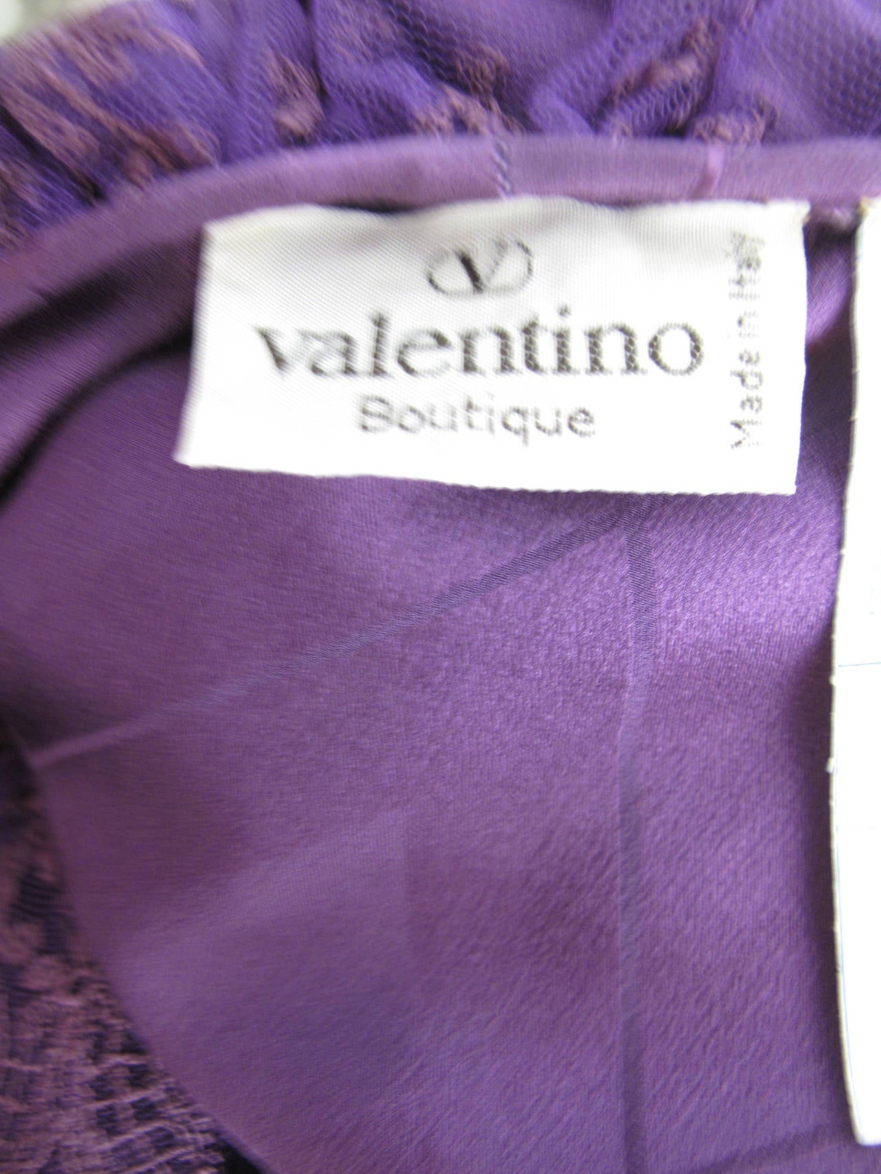"Valentino purple silk blouse. Condition: Excellent.  38"" bust, 38"" waist, 24"" sleeve, 17"" shoulder, 25 1/2"" length. Size : large