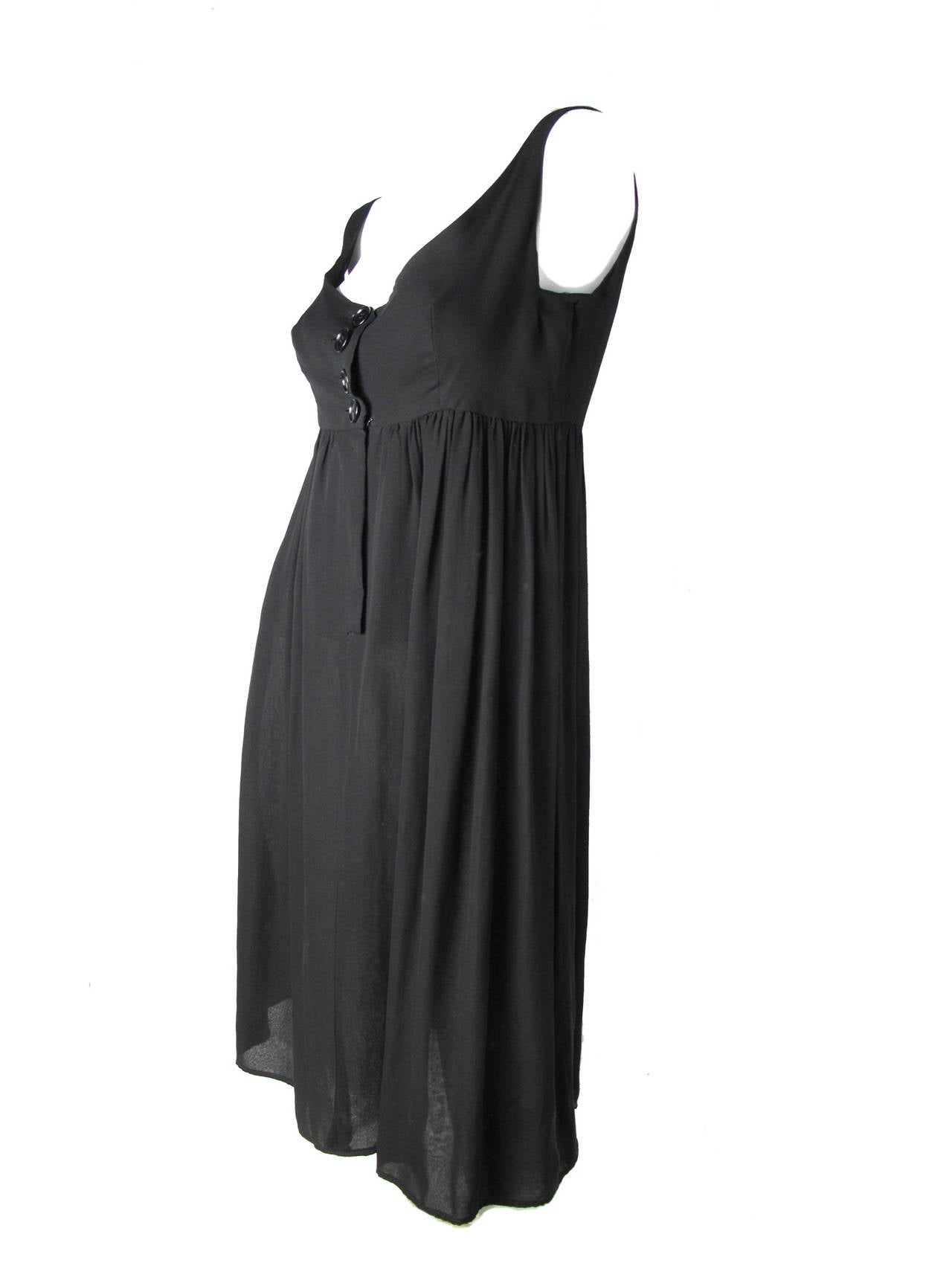"1960s Rudi Gegnerisch black silk chiffon dress. Two layers of sheer chiffon, sewn together at hem.   34"" bust, 29"" waist, 60"" hips, 37 1/2"" length.  Condition: Fair, tear in armhole has been re-stitched.  small holes on back of"