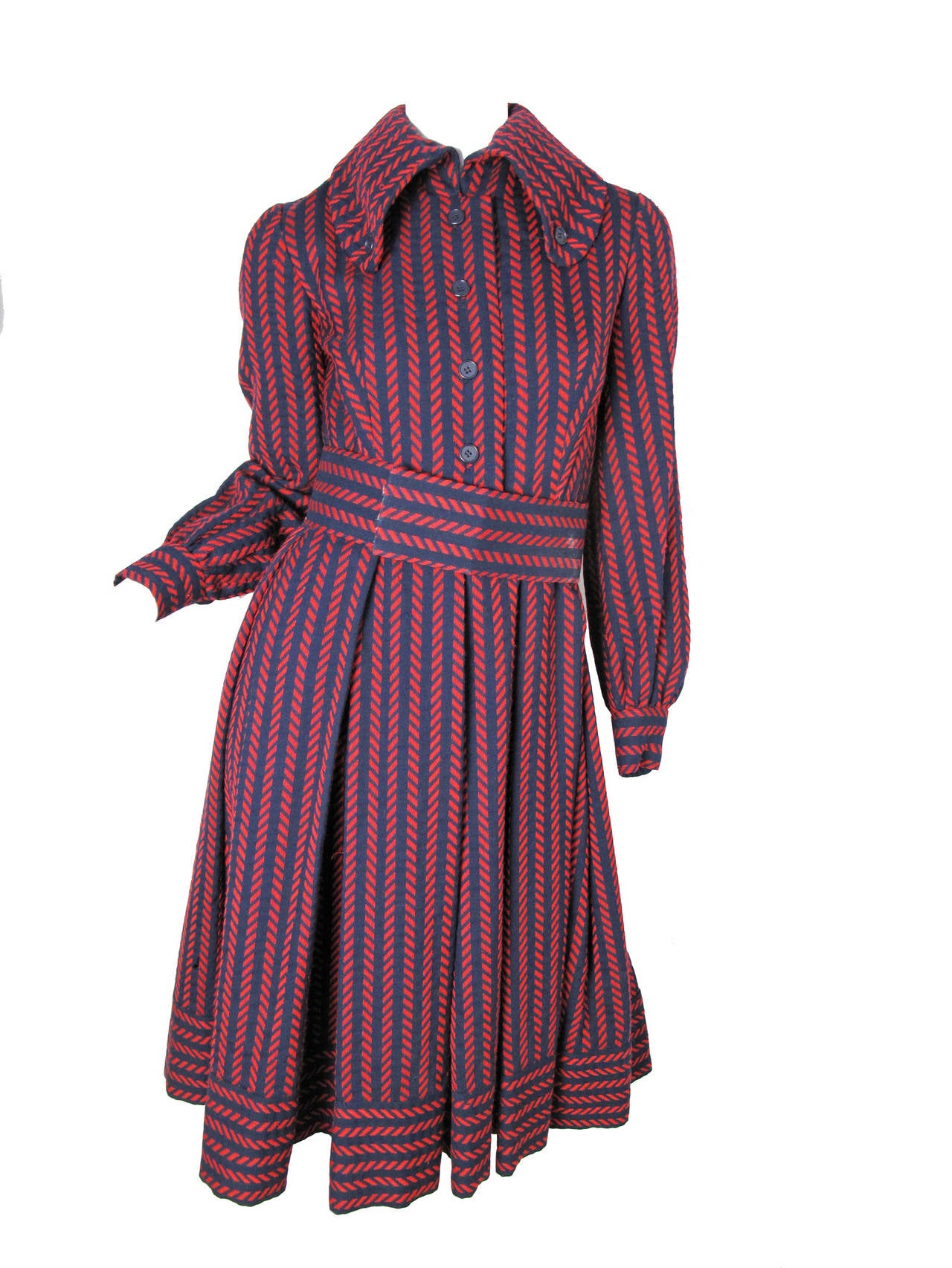 1970s Geoffrey Beene navy and red wool coat dress with belt and removable tie at neck.  Lined. Condition: As is, a few holes, see photos. They do not go through to lining.  