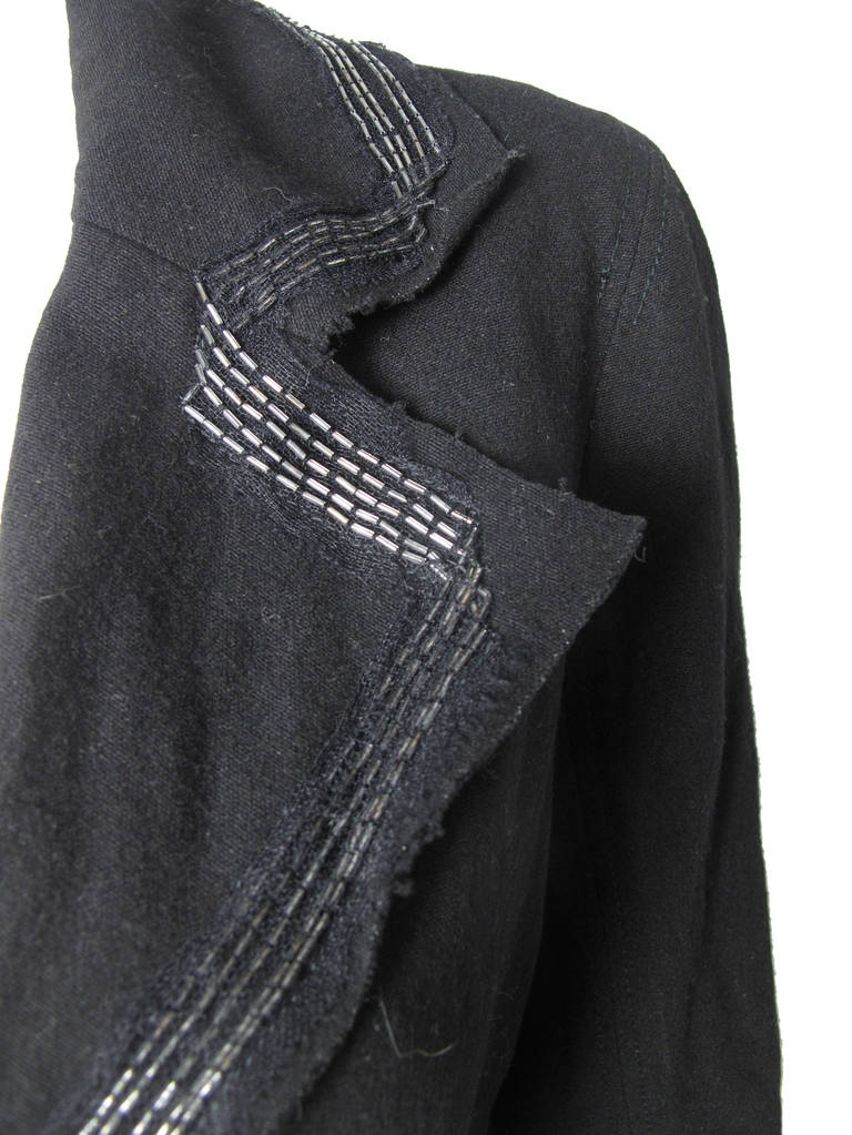 """Lanvin River 2005 black wool felt sailor jacket with beaded trim and cuffs. 38"""" bust, 34""""waist, 23"""" sleeve, 15"""" shoulder, 22"""" length.  Condition: Excellent. Size 38 / US Med"""