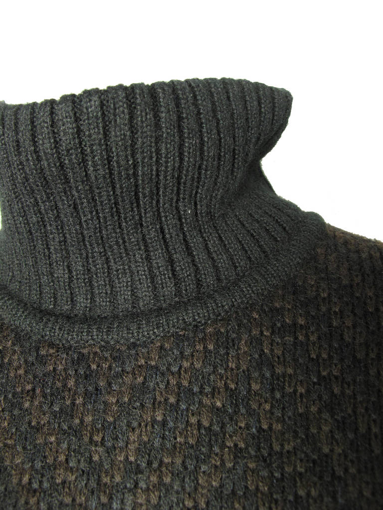 Alaia brown and black knit sweater dress.  Wool, mohair, acrylic,  Two front pockets.  Snaps at neck on back.  48