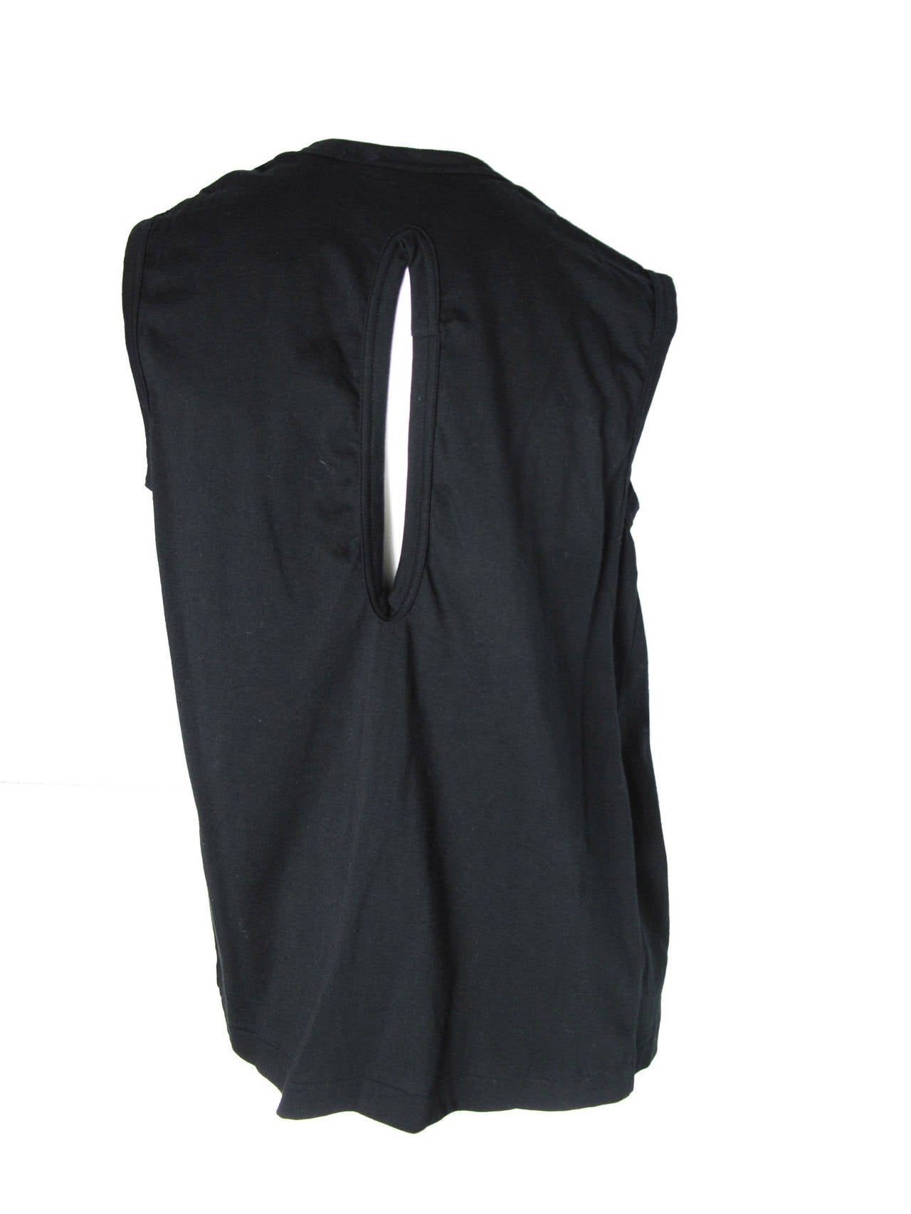 2006 Comme des Garcons black cotton top with slash on back and no closure on front.    34
