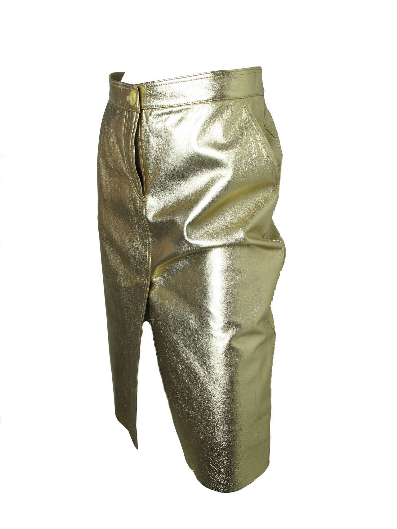 "Moschino gold leather (sheep skin) metallic skirt.  Two front pockets.  32"" waist, 36"" hips, 25"" length. Condition: Excellent.   Size 8"