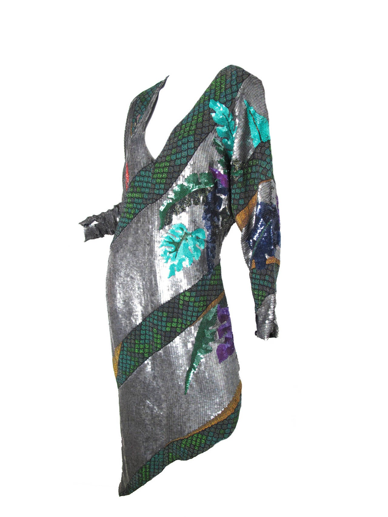 Rare beaded and sequined Krizia snake dress.  Snake wraps around and around dress.  Condition: Excellent, looks new. Size 42/ US 8  We accept returns for refund, please see our terms.  We offer free ground shipping within the US.   *this listing