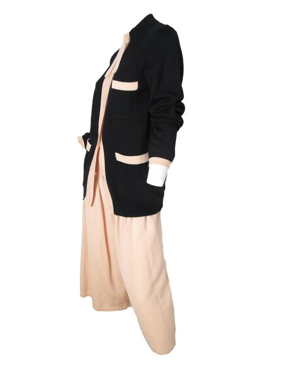 1980s Sonia Rykiel black wool knit cardigan with pale peach trim and peach culottes.  Three font pockets on cardigan. Pants are lined. Condition: Excellent. 