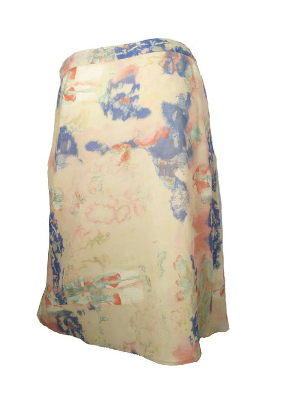 """Christian Lacroix silk pastel watercolor skirt.  Condition: Excellent. Made in France. Size 40 / US 6 - 8  31"""" waist, 40"""" hips, 24"""" length.  We accept returns for refund, please see our terms.  We offer free Ground Shipping within the US.  Please"""