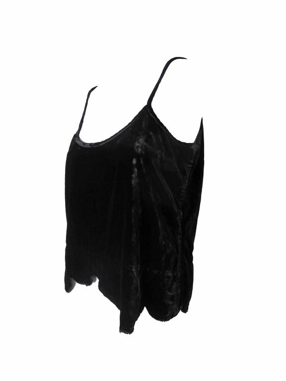 """Comme des Garcons black velvet tank with distressed scalloped hem.  Zipper on side.  Condition: Excellent. Size L 37"""" bust, 36"""" waist, 40"""" hips, 22 1/2 length.   We accept returns for refund, please see our terms.  We offer free Ground Shipping"""