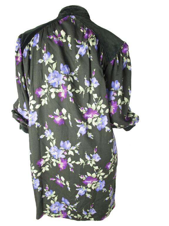 1980s Yves Saint Laurent Rive Gauche green and purple wool floral sack dress with velvet cuffs and neckline.  Zipper on front, two side pockets. Condition: As is, multiple moth holes on underneath side of right sleeve and some on front .  Size