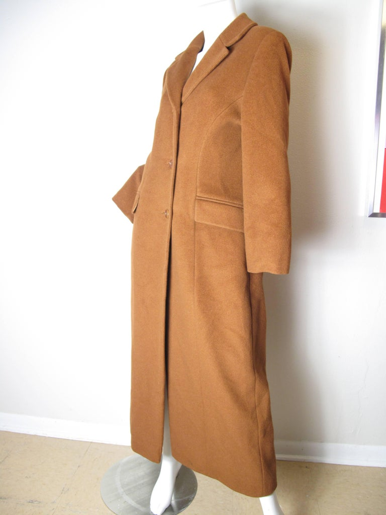 Gorgeous Guy Laroche Brown Wool Coat. Two front pockets, buttons down front. Condition: Excellent. Size 42/ US 8  ( mannequin is size 6 )  We accept returns for refund, please see our terms.  We offer free ground shipping within the US