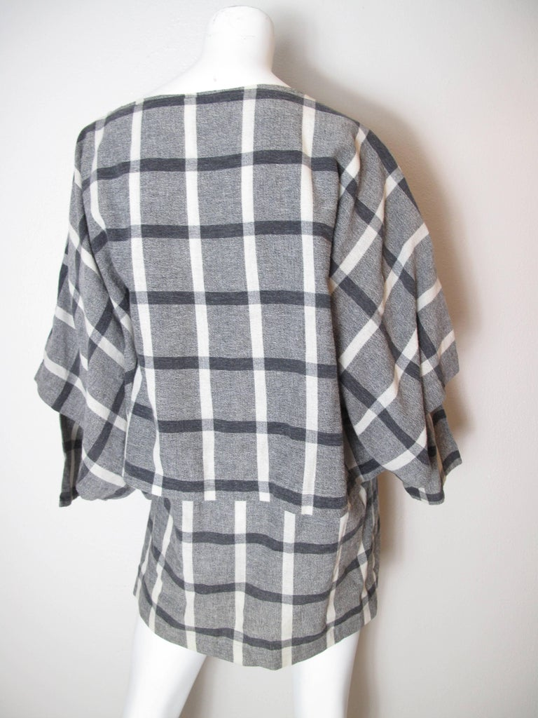 """Issey Miyake Plantation check tunic. Feels like linen.  Condition: good, some discoloration.  Size L  52"""" bust, 46"""" waist, 31 1/2"""" length."""