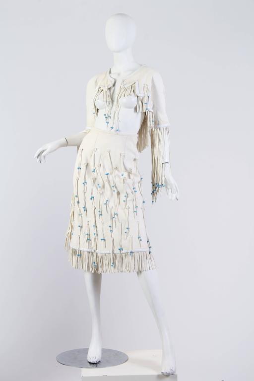 White suede sculpture dress.