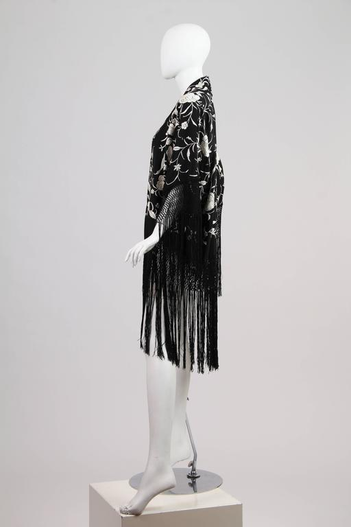 Fringed Kimono made from Antique Piano Shawl. The shawl dates to the early half of the 20th century, all embroidery is done by hand. We made this piece inspired from the works of Paul Poiret of the 1920s and how he would use antique shawls just like