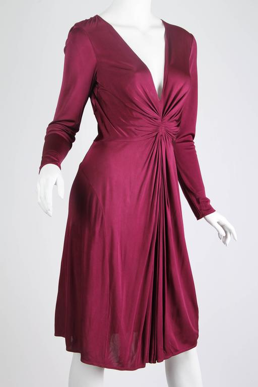 Gorgeous body flowing and flattering cut to this luscious dress from none other than Alexander McQueen.