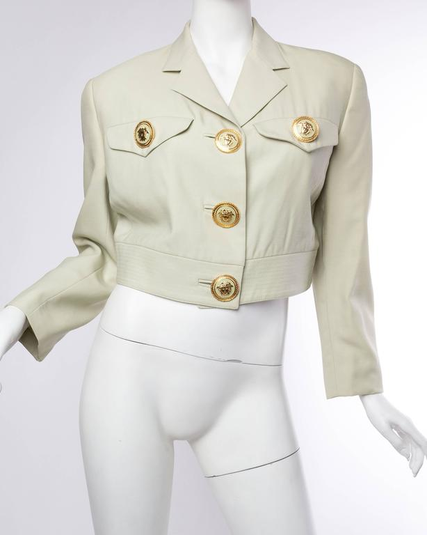 Dating from the early 1990s this pastel jacket, originally sold at Bergdorf Goodman, is adorned with large fantastic Medusa buttons.