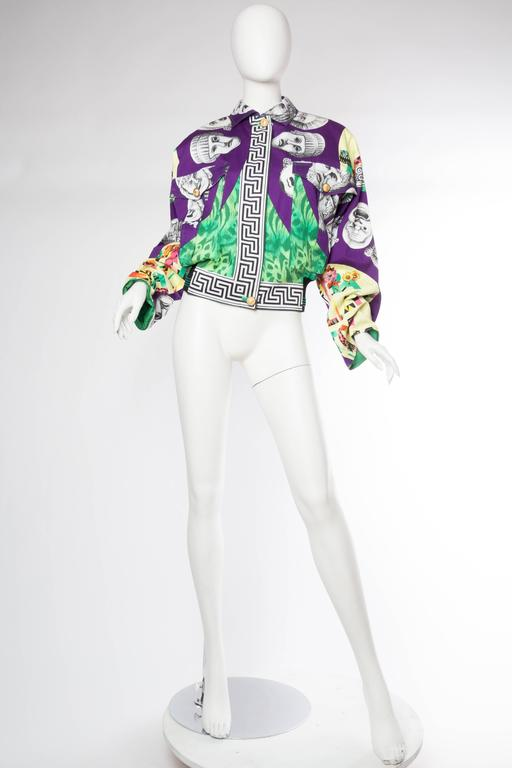 New with tags this bomber style jacket is far cooler than all the Fran Drescher style printed Versace blazers out there. Push the sleeves up and pop the collar and wear with an ultra casual sporty look. May the Greek gods be with you.
