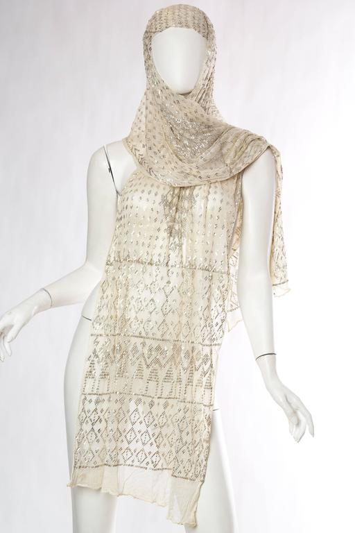 Shawl is in good clean condition and has been woven with silver metal to add weight and glimmer. Pinned on the mannequin to show how it can also become a dress which we can sew for you if you desire.