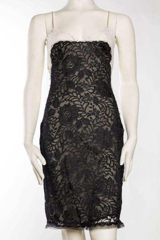 Unheard of to find these rare naked dresses from the master Geoffrey Beene. Dress is in near flawless condition and is made from two layers of chiffon and a layer of lace. The two layers of chiffon have been sewn together at the hem with a scalloped