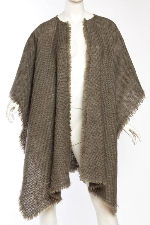 Made from the most beautiful wool woven with a magical fiber which makes this piece lighter than air. This poncho can also be wrapped around the shoulders and worn a variety of ways, try it belted!