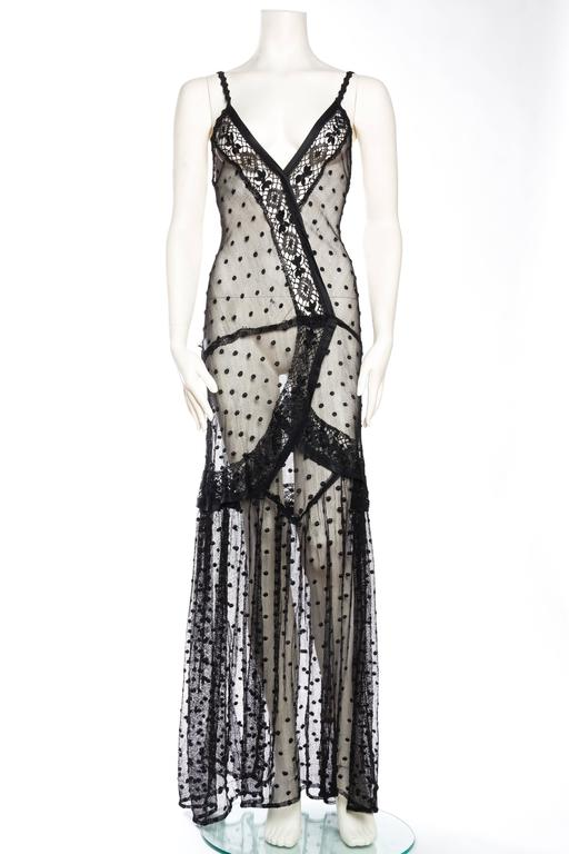 Dress has been altered from it's original design however it is slinky and sexy and ready for todays woman to wear.