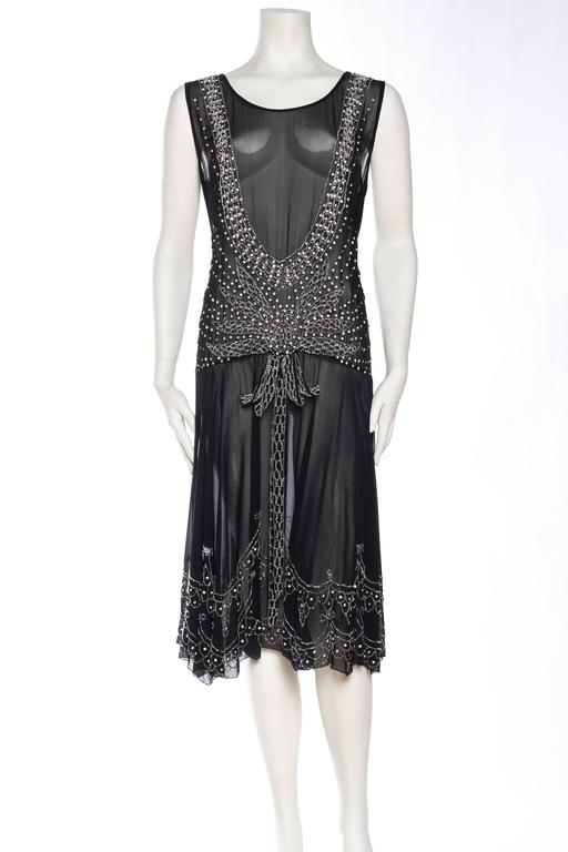 Pictures never really can capture the beautiful sparkle of antique crystals and beads. This Art Deco dress has an abundance of crystals which drape around the body beautifully.