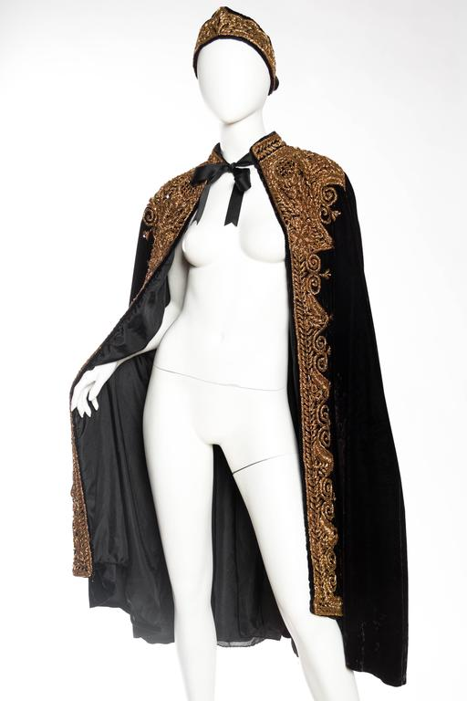 Cape is fully lined and comes with a matching belt which ties to fit many sizes.