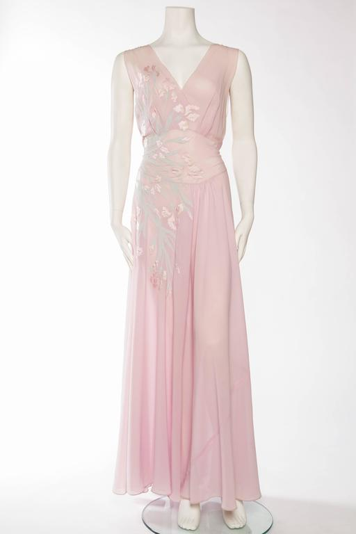 This by far is the most phenomenal negligee we have ever seen. The sheer mastery of the couture seamstress who appliquéd the delicate strips of silk chiffon and satin onto the bias cut of this piece is mind boggling. Also a rare larger size however