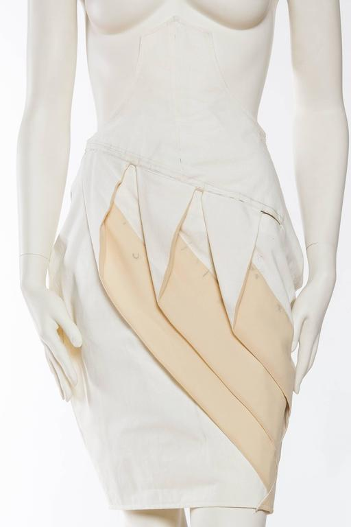 This piece was purchased directly from John Galliano's archive in Paris upon his ousting from Dior. He needed to streamline things and thus a sale was held. There is of course no label sewn into this piece as it was used as a working toille to
