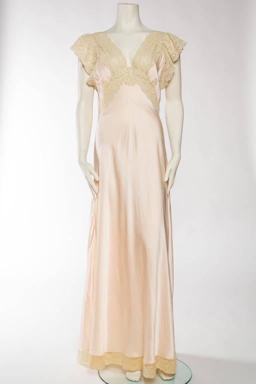 Dating from the 1930s/40s this negligee is a rare silk one, not rayon like many from the era. Most likely made in France where these superior slip dresses were made.